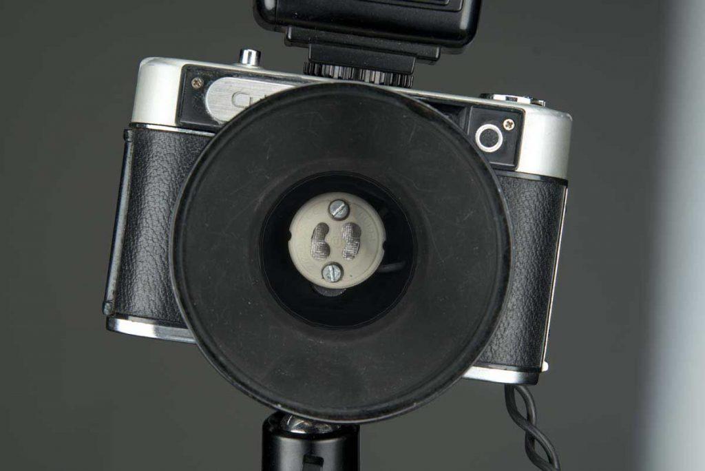 Lámparas con cámaras fotográficas
